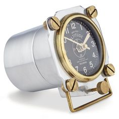 """Cast, machined aluminum and brass, measuring 5"""". Based on altimeters from WWII aircraft with its stout brass screws and rugged shape, this clock brings fighter pilot precision to your desk. Its authen"""