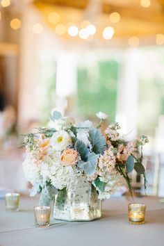 Pink and grey centrepiece | silver Mercury glass vase and votive candle holders | White Oaks Ranch Wedding by Apryl Ann - Southern Weddings Magazine