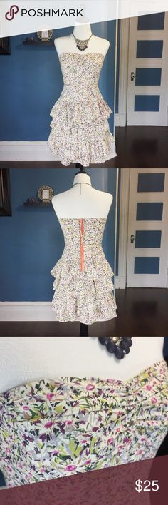 """J. Crew Daisy Day Dress J. Crew Daisy Day Strapless Dress is fun and flirty. The floral print is from London's famed Liberty Art Fabric. The contrast of the neon pull zipper in the back adds a uniqueness to the dress.  It also has an interior corset for added support. Approximate measurements: waist: 14""""; length: 27""""; armpit to armpit: 15"""". Worn but like- new. J. Crew Dresses Midi"""