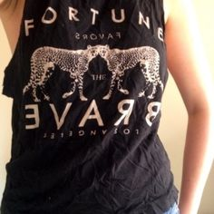 Graphic Tee Tank top from Forever 21. Size small. Dips a little on the sides, looks cute over a bralette or swimsuit! Perfect for warmer weather! Forever 21 Tops Muscle Tees