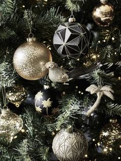 modern christmas tree These deco-inspired Christmas decorations have us all set for a season of splendour. This festive take on the tropical trend mixes palm trees and pineapples with luxe gold baubles. Black Christmas Tree Decorations, Black Christmas Trees, Christmas Mood, Christmas Ornaments, Christmas Games, Modern Christmas, Thanksgiving Decorations, Christmas Sweaters, Christmas Tree Inspiration