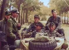 A Panzer IV Ausf. H Crew of the 22nd Pz. Regt., 21st Pz. Division - The young German Leutnant wears a fallschirmjäger tunic Heer eagle and collar tabs applied- tucked into his Pz trousers! They are resting outside 50, Boulevard des Belges, Rouen,...