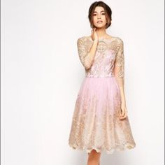 Beautiful NWT dress! Bought as an option for my wedding dress, and I couldn't return it. US 10/UK 14, one string loose on the sleeve (pictured) but otherwise perfect. Bodice is lighter than the web pics, ombré cream into pink skirt.  ModCloth sells  a versions for $140, ASOS $135 which is what I paid.  Woven fabric with all over metallic lace detail, sweetheart bodice, full skirt, scallop hem.  Can't buy in U.S. except online!
