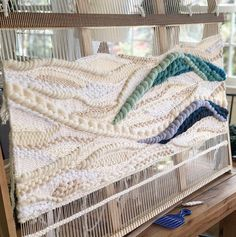 Progress shot ➰ This baby's coming along! Weaving Loom Diy, Weaving Art, Tapestry Weaving, Hand Weaving, Weaving Textiles, Textile Fabrics, Weaving Patterns, Weaving Wall Hanging, Fabric Rug