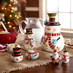 Gift idea for bakers: Christmas cookie jars or holiday measuring sets.