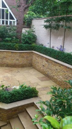 New Riven Yorkstone looks great in traditional landscapes due to it's riven surface, as seen in this garden design by Shoots and Leaves.