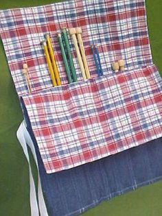 """Easy way to store all your Knitting needles! Take 2 placemat and sew along the edges. Leave about 4"""" or so and about every 2 or 3"""" sew from from the bottow up to where the opening should be."""