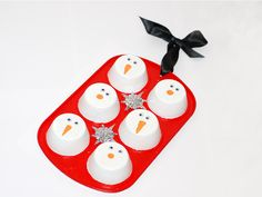 DIY Snowman Cupcake Tin Decoration—recycle your old muffin tin into this holiday-spirited hanging! (ivillage)