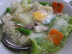 Filipino Hototay Soup: Hototay soup is a combination of meat-and-vegetables with slivers of pork meat, pork liver, chicken gizzards, dumplings, mushrooms and vegetables in a clear broth garnished with raw eggs.