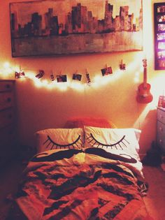ukulele stand, lights and bed on the floor