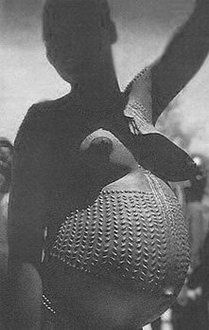 African scarification to decorate and beatify the body. Pregnant Woman with Body Scarification - Photographers Unknown
