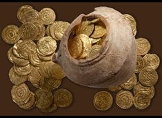 HERZLIYA, Israel, July 11- A 1,000-year-old hoard of gold coins has been unearthed at a famous Crusader  battleground where Christian and Muslim forces once fought for control of the Holy Land, Israeli archaeologists said on  Wednesday. The treasure was dug up from the ruins of a castle in Arsuf, a strategic stronghold during the religious conflict waged in the 12th and 13th centuries.
