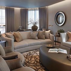 Neutral with a hint of burnt orange  in our Chelsea apartment project. Love the curved walls in this space- we templated the shape of the curved window wall for a bespoke desk to sit here and look out across the city. (Behind the sofa and console with the plant) -detail shot to follow soon #behindthedesign #sophiepatersoninteriors #luxuryinteriors #coffeetable #rug #interiordesign #interiorsinspo #homedecor #housegoals #london #luxury #chelsea