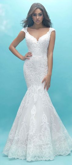 Lace and beaded embroidery pair for a gorgeously textured gown, featuring a flared skirt and petite cap sleeves.