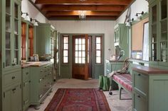 Green mudroom with fishing gear storage -- Ashley Campbell Interior Design, ashleycampbell.com -- emr photography