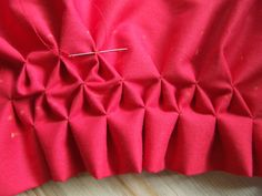 Great honeycomb smocking tutorial.  Very clear.  Also gives yardage for adapting to your patterns!