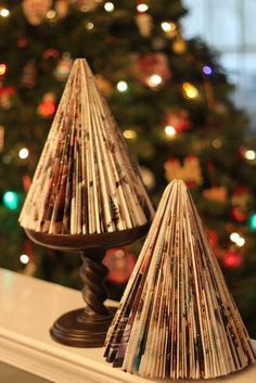 Recycled Magazine DIY:: Christmas Trees  @Sherry Anderson remember making these out of old sears catalogs