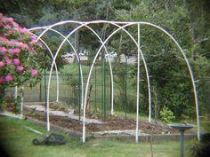 Walk in garden fencing over PVC hoops with netting.