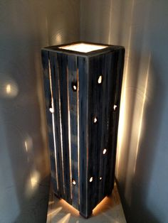 Hand crafted rustic reclaimed wood lamp. $100.00, via Etsy.