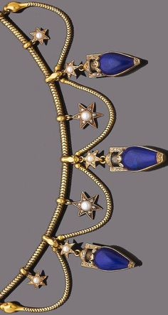A lapis lazuli, pearl and diamond fringe necklace, circa 1860 The snake-link chain suspending to the front three lapis lazuli and rose-cut diamond urns, each suspended from pearl and rose-cut diamond star motifs and polished snake head surmounts, spaced by snake-link swags, pearls remain untested, length 40.0cm., fitted case by London & Ryder, 17, New Bond St.