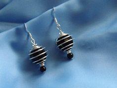 Sterling Silver Earrings, Black, Caged Bead, �5.00