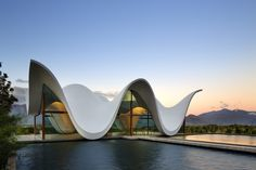 Designed by architect Coetzee Steyn of Steyn Studio, the Bosjes chapel in the Breedekloof Wine Valley has a dramatically curved, flowing roof that makes the entire building appear to float on two large ponds of water. Cultural Architecture, Religious Architecture, Organic Architecture, Amazing Architecture, Architecture Design, Church Architecture, British Architecture, Parametric Architecture, Innovative Architecture