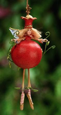 Since it's Holloween I thought I'd try to scare y'all with this extremely overpriced ornament of Persephone combined with a pomegranate.