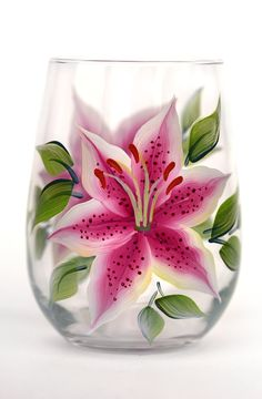 Stargazer lilies with deep pink with white edged petals, deep burgandy speckling and deep green leaves hand-painted encircling a quality 17 oz stemless wine glass. Sealed and heat-cured for added dura