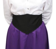 Put the finishing touch on your outfit with this waist flattering belt.  Features a bone front diamond that tapers in the back to 2 sets of metallic buttons, which allow you to adjust the belt length. Diamond measures approximately 8-9 inches in the front and tapers to approximately 3 inches in the back.Made of 100% cotton. Available in sizes XS - 3X. Imported. Button styles may vary. Also available in Black Velvet.
