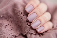 Square tips and lilac nails.