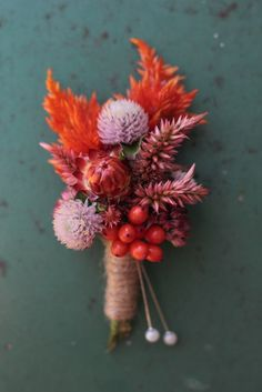 Boutonniere -- Love 'n Fresh Flowers. Celosia, gomphrena, berries.