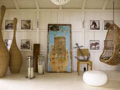 Artwork, planked walls, and a swing. Thom Filicia design.