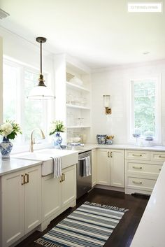 White kitchen brass hardware white farm sink with industrial pendant light and brass faucet kitchen styling . Home Decor Kitchen, White Kitchen Decor, Kitchen Lighting Remodel, White Kitchen Remodeling, Kitchen Decor, Kitchen Faucet, White Modern Kitchen, White Farm Sink, Brass Kitchen Hardware