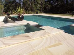 Gosford Quarries supplies high-quality, eco-friendly sandstone tiles and pool pavers for residential and commercial clients throughout Australia. Pool Pavers, Backyard Pool Landscaping, Backyard Pool Designs, Pool Tiles, Pool Coping, Sandstone Pavers, Pool Finishes, Pool Landscape Design, Pool Remodel