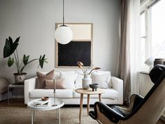 I've got a beautiful and inspiring little pad for you today! Styled by Grey Deco, this home has a simple and harmonious look. The warm, restrained Scandinavian Apartment, Scandinavian Style, Scandinavian Interiors, White Interiors, Casa San Sebastian, Living Room Decor, Living Spaces, Living Rooms, Black Armchair