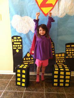 Superhero party - homemade photo backdrop. Great idea @Lisa Goldstein!!