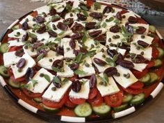 Having just recently spent a few weeks in July on the isle of Syros, I found out what a true Greek salad is. This salad is placed on the table family style and generally serves 2 to 4 people; it is easily doubled or tripled.