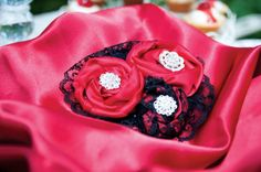 The Elegant Trio-red satin ribbon, black lace, and silver brooches as centerpieces.