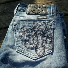 "Miss Me Fleur de Lis Straight Leg Jeans! Fleur de Lis design on the back pocket. Straight leg design, inseam 31"". EUC. Small x on the inside waist. Miss Me Jeans Straight Leg"