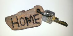 Homemade key ring. Made from a piece of wood found nearby.