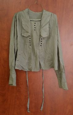 1916-1918 'teens blouse. Cute little button decorations. Would be pretty in navy or black skirt w/ matching color buttons  *ebay*