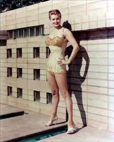 "Esther Williams (August 8, 1922 - ) is a United States competitive swimmer and 1940s and 1950s movie star. Known as ""America's Mermaid,"" she was famous for her musical films that featured elaborate performances with swimming, diving and ""water ballet,"" which is now known as synchronized swimming. Gorgeous Vintage Swimsuits."