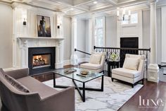 Country Neutral Library with Limestone Fireplace Surround | LuxeSource | Luxe Magazine - The Luxury Home Redefined