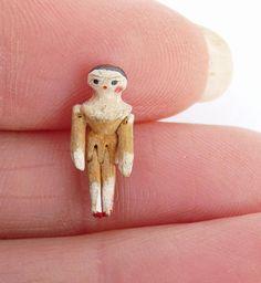 Worlds tiniest antique 19thc miniature wooden peg doll 1.7cm limbs move