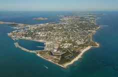 """Cayo Hueso(Spanish pronunciation:[ˈkaʝo ˈweso]) is the originalSpanishname for the island of Key West. Spanish-speaking people today also use the termCayo Huesowhen referring to Key West. It literally means """"bone cay (a low island or reef)"""". It is said that the island was littered with the remains (bones) of prior native inhabitants, who used the isle as a communal graveyard."""