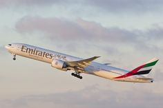 A picture of an Emirates Boeing 777-31H(ER) plane climbing after take off from Los Angeles International Airport (LAX/KLAX). The aircraft registration is A6-ECU