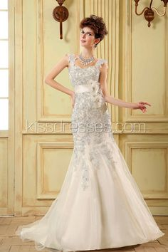 Lace fabric mermaid style with romantic tulle straps wedding gown