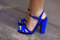 Blue sandals modeled by Evelina Barry