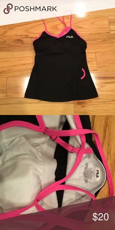 Fila workout tank Super cute, strappy workout tank. Built in bra. Never worn. Tags removed. Fila Tops Tank Tops