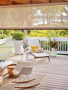 A motorized retractable screen tempers nature's extremes—glaring sun and buzzing insects—to ensure a pleasant gathering. More porch ideas: http://www.midwestliving.com/homes/outdoor-living/45-ideas-for-warm-and-welcoming-porches/?page=33